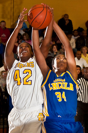 Reynoldsburg High School's #42 Destini Cooper and Gahanna Jefferson High School's #34 Zenobia Bess vie for a rebound in the first period of play at Reynoldsburg High School Friday night February 12, 2010. (Photo by James D. DeCamp 614-462-8027)