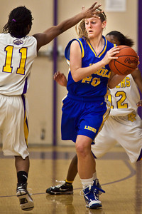 Reynoldsburg High School's #11 Whitney McKoy, left, and #32 Kenyell Goodson, right, try to guard Gahanna Jefferson High School's #20 Casey Salopek in the second period of play at Reynoldsburg High School Friday night February 12, 2010. (Photo by James D. DeCamp 614-462-8027)
