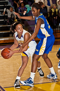 Reynoldsburg High School's #10 Kacia Grant gets underneath Gahanna Jefferson High School's #34 Zenobia Bess in the first period of play at Reynoldsburg High School Friday night February 12, 2010. (Photo by James D. DeCamp 614-462-8027)