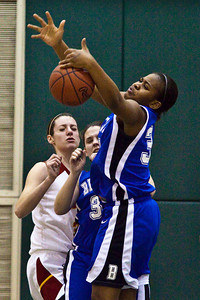 Bexley High School's #34 Amubie SamAgwor tries to get her hands on a rebound in the second period of play at Dublin Scioto High School in the Central District Division II playoffs held Wednesday night February 24, 2010. (Photo by James D. DeCamp 614-462-8027)