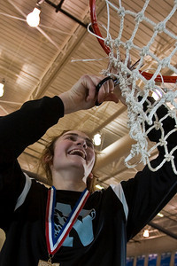 Pickerington North High School's #32 Michele Hare cuts down part of the net following their win over New Albany High School in the fourth period of play at Olentangy Liberty High School in the Central District Division I finals held Saturday afternoon March 6, 2010. (Photo by James D. DeCamp | http://www.OhioPhotojournalist.com | 614-462-8027)