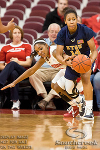 Ohio State University's Senior Guard Alison Jackson (#12) and East Tennessee State's Freshman Guard Shawn Randall (#14) in the first period of play at the Value City Arena at The Jerome Schottenstein Center in Columbus, Ohio Monday evening November 22, 2010. The Buckeyes defeated the Lady Bucs 80-47. (© James D. DeCamp / Southcreek Global Media) | All Rights Reserved | http://www.southcreekglobal.com | For all sales contact: sales@southcreekglobal.com | 1-800-934-5030