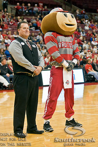 Brutus Buckeye mocks an usher during a time-out in the first period of play at the Value City Arena at The Jerome Schottenstein Center in Columbus, Ohio Monday evening November 22, 2010. The Buckeyes defeated the Lady Bucs 80-47. (© James D. DeCamp / Southcreek Global Media) | All Rights Reserved | http://www.southcreekglobal.com | For all sales contact: sales@southcreekglobal.com | 1-800-934-5030