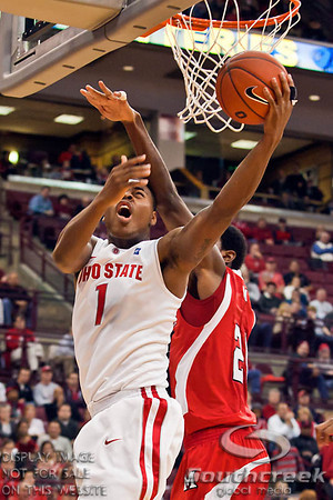 Ohio State University's Freshman Forward Deshaun Thomas (#1) gets around Miami (OH) University's Senior Forward Nick Winbush (#20) in the second period of play at the Value City Arena at The Jerome Schottenstein Center in Columbus, Ohio Friday afternoon November 26, 2010. The Buckeyes defeated the RedHawks 66-45.  (© James D. DeCamp / Southcreek Global Media) | All Rights Reserved | http://www.southcreekglobal.com | For all sales contact: sales@southcreekglobal.com | 1-800-934-5030