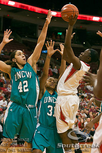 Ohio State University's Sophomore Guard Amber Stokes (#3) goes up against University of North Carolina Wilmington's Senior Guard/Forward Treasure Johnson (#31) and University of North Carolina Wilmington's Senior Center Martha White (#42) in the first period of play at the Value City Arena at The Jerome Schottenstein Center in Columbus, Ohio Sunday afternoon November 28, 2010. The Buckeyes defeated the Lady Seahawks 88-69.   (© James D. DeCamp / Southcreek Global Media) | All Rights Reserved |http://www.southcreekglobal.com | For all sales contact: sales@southcreekglobal.com | 1-800-934-5030