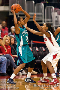 Ohio State University's Senior Guard Alison Jackson (#12) and University of North Carolina Wilmington's Junior Guard Kristen Hanzer (#21) in the first period of play at the Value City Arena at The Jerome Schottenstein Center in Columbus, Ohio Sunday afternoon November 28, 2010. The Buckeyes defeated the Lady Seahawks 88-69.   (© James D. DeCamp / Southcreek Global Media) | All Rights Reserved |http://www.southcreekglobal.com | For all sales contact: sales@southcreekglobal.com | 1-800-934-5030