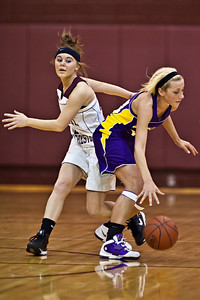 Canal Winchester High School's #23 Kaleigh Whitlatch and #34 Alexis Donahue vie for a loose ball during her teams game against Bloom-Carroll High School Friday night December 10, 2010 at Canal Winchester High School. (Photo by James D. DeCamp | http://www.OhioPhotojournalist.com | 614-462-8027)