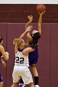 Canal Winchester High School's #22 Cadyn Krauss gets under #11 Abby Seymour in a rebound attempt during her teams game against Bloom-Carroll High School Friday night December 10, 2010 at Canal Winchester High School. (Photo by James D. DeCamp | http://www.OhioPhotojournalist.com | 614-462-8027)