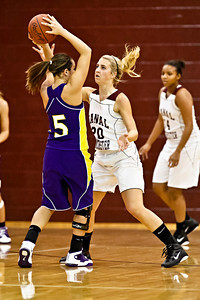 Canal Winchester High School's #20 Kayla Scott guards #5 Ashley Milligan during her teams game against Bloom-Carroll High School Friday night December 10, 2010 at Canal Winchester High School. (Photo by James D. DeCamp | http://www.OhioPhotojournalist.com | 614-462-8027)