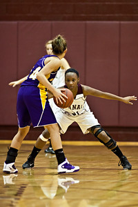 Canal Winchester High School's #31 Tay Stokes guards #14 Sadie Evans during her teams game against Bloom-Carroll High School Friday night December 10, 2010 at Canal Winchester High School. (Photo by James D. DeCamp | http://www.OhioPhotojournalist.com | 614-462-8027)