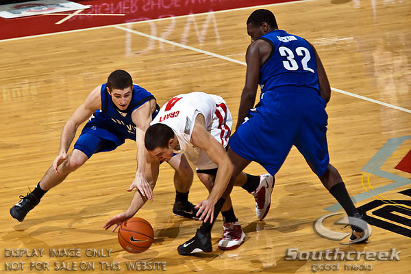 Ohio State University's Freshman Guard Aaron Craft (#4) gets between University of North Carolina Asheville's Junior Guard Matt Dickey (#2) and University of North Carolina Asheville's Junior Forward Quinard Jackson (#32) in the second period of play at the Value City Arena at The Jerome Schottenstein Center in Columbus, Ohio Tuesday evening December 21, 2010. The Buckeyes defeated the Bulldogs 96-49.   (© James D. DeCamp / Southcreek Global Media) | All Rights Reserved http://www.southcreekglobal.com | For all sales contact: sales@southcreekglobal.com | 1-800-934-5030