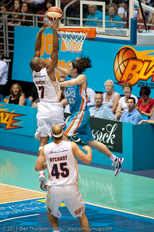 "Chris Goulding plays strong defence on Ron Dorsey's drive to the basket - Gold Coast Blaze v Cairns Taipans NBL Basketball, Wednesday 19 January 2011; Gold Coast Convention & Exhibition Centre, Broadbeach, Queensland, Australia. Photos by Des Thureson:  <a href=""http://disci.smugmug.com"">http://disci.smugmug.com</a>"