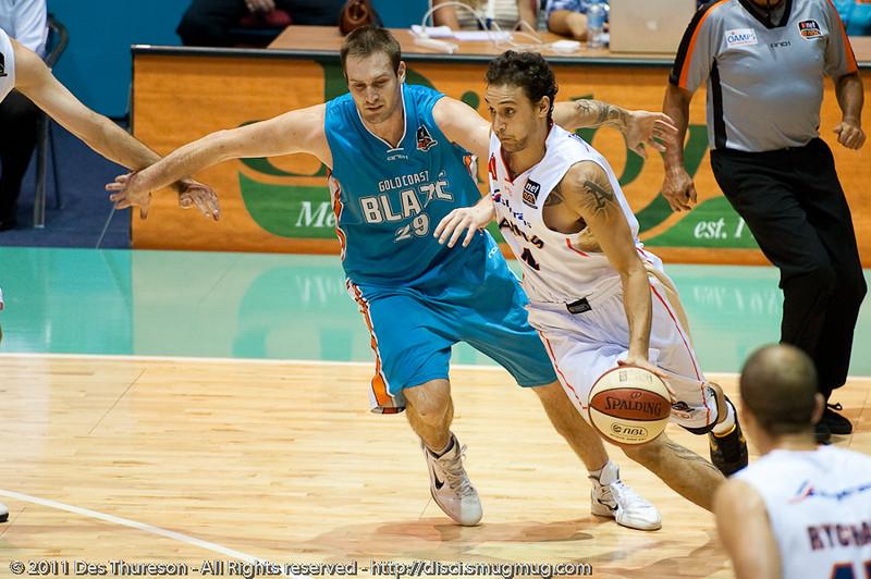 """Mark Worthington, Lindsay Tait - Gold Coast Blaze v Cairns Taipans NBL Basketball, Wednesday 19 January 2011; Gold Coast Convention & Exhibition Centre, Broadbeach, Queensland, Australia. Photos by Des Thureson:  <a href=""""http://disci.smugmug.com"""">http://disci.smugmug.com</a>"""