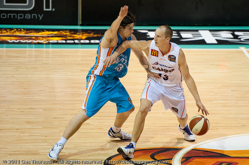"Chris Goulding and Kiwi Olympian Phill Jones pressure each other - Gold Coast Blaze v Cairns Taipans NBL Basketball, Wednesday 19 January 2011; Gold Coast Convention & Exhibition Centre, Broadbeach, Queensland, Australia. Photos by Des Thureson:  <a href=""http://disci.smugmug.com"">http://disci.smugmug.com</a>"