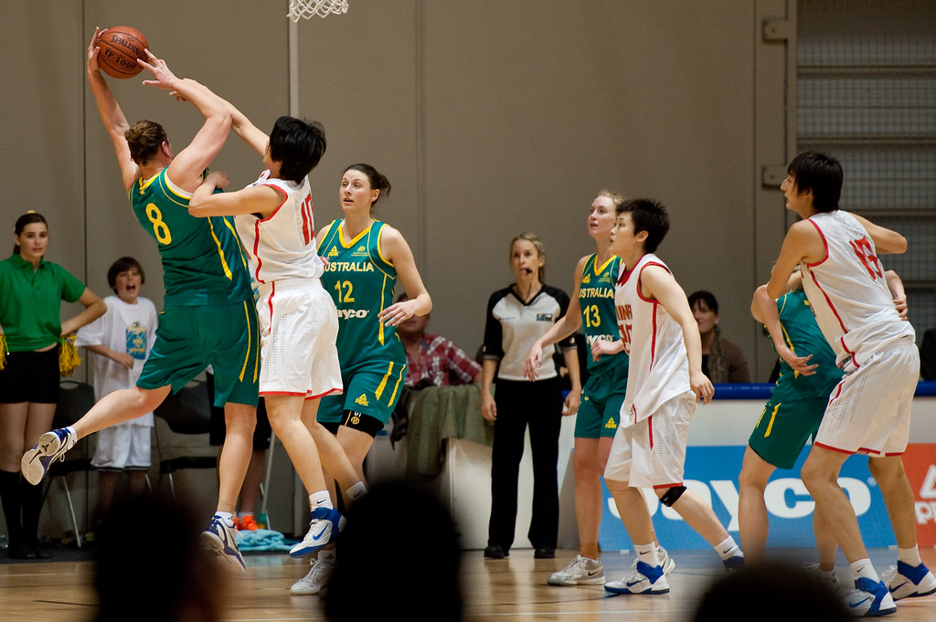 """Suzy Batkovic, Fan Zhang - Opals v China International Women's Basketball, Logan Metro Sports Centre, Crestmead, Queensland, Australia; 24 July 2011. Photos by Des Thureson:  <a href=""""http://disci.smugmug.com"""">http://disci.smugmug.com</a>."""