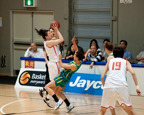 """Kristen Veal, Yuan Ding - Opals v China International Women's Basketball, Logan Metro Sports Centre, Crestmead, Queensland, Australia; 24 July 2011. Photos by Des Thureson:  <a href=""""http://disci.smugmug.com"""">http://disci.smugmug.com</a>."""