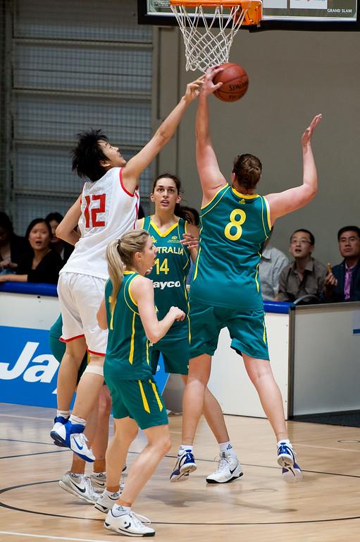 """Suzy Batkovic, Song Gao - Opals v China International Women's Basketball, Logan Metro Sports Centre, Crestmead, Queensland, Australia; 24 July 2011. Photos by Des Thureson:  <a href=""""http://disci.smugmug.com"""">http://disci.smugmug.com</a>."""