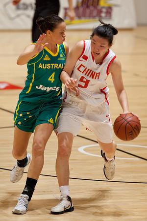 """Kristen Veal v Yuan Ding - Opals v China International Women's Basketball, Logan Metro Sports Centre, Crestmead, Queensland, Australia; 24 July 2011. Photos by Des Thureson:  <a href=""""http://disci.smugmug.com"""">http://disci.smugmug.com</a>."""