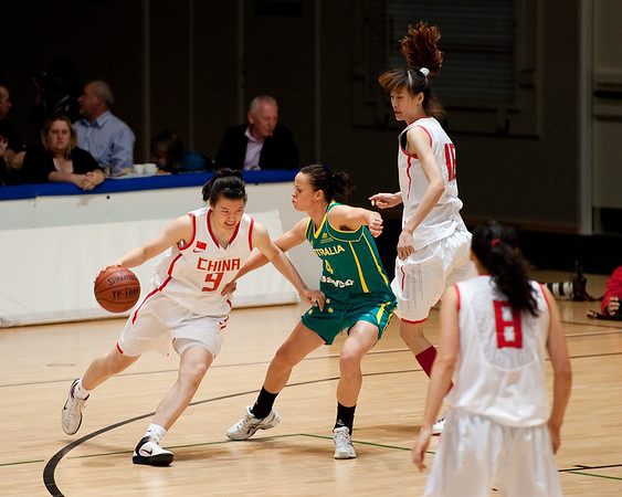 Kristen Veal, Yuan Ding - Opals v China International Women's Basketball, Logan Metro Sports Centre, Crestmead, Queensland, Australia; 24 July 2011. Photos by Des Thureson: http://disci.smugmug.com.