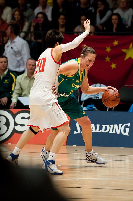 """Suzy Batkovic, Yanyan Ji - Opals v China International Women's Basketball, Logan Metro Sports Centre, Crestmead, Queensland, Australia; 24 July 2011. Photos by Des Thureson:  <a href=""""http://disci.smugmug.com"""">http://disci.smugmug.com</a>."""