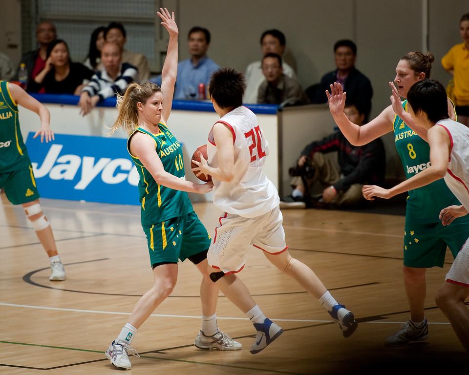 "Stephanie Cumming, Yanyan Ji - Opals v China International Women's Basketball, Logan Metro Sports Centre, Crestmead, Queensland, Australia; 24 July 2011. Photos by Des Thureson:  <a href=""http://disci.smugmug.com"">http://disci.smugmug.com</a>."