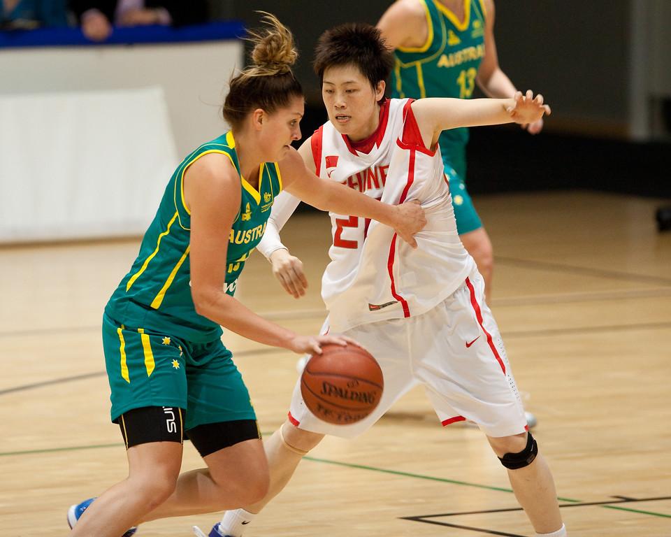 """Cayla Francis, Yanyan Ji - Opals v China International Women's Basketball, Logan Metro Sports Centre, Crestmead, Queensland, Australia; 24 July 2011. Photos by Des Thureson:  <a href=""""http://disci.smugmug.com"""">http://disci.smugmug.com</a>."""