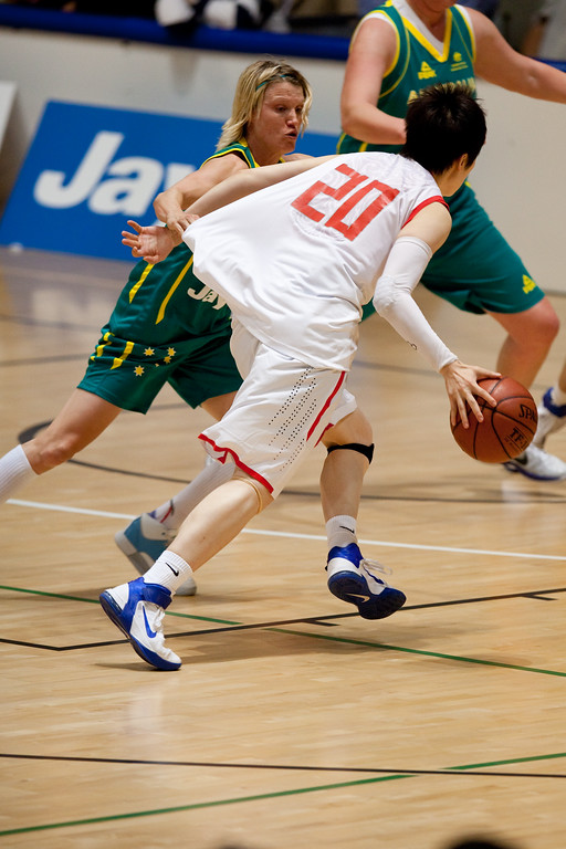 """Jessica Bibby, Yanyan Ji - Opals v China International Women's Basketball, Logan Metro Sports Centre, Crestmead, Queensland, Australia; 24 July 2011. Photos by Des Thureson:  <a href=""""http://disci.smugmug.com"""">http://disci.smugmug.com</a>."""