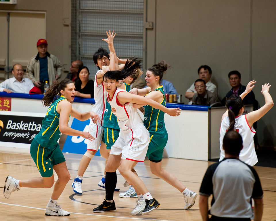 "Elyse Penaluna, Nan Chen - Opals v China International Women's Basketball, Logan Metro Sports Centre, Crestmead, Queensland, Australia; 24 July 2011. Photos by Des Thureson:  <a href=""http://disci.smugmug.com"">http://disci.smugmug.com</a>."