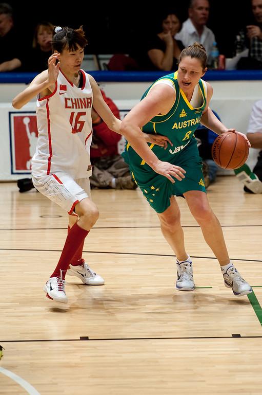 """Suzy Batkovic, Nuo Xu - Opals v China International Women's Basketball, Logan Metro Sports Centre, Crestmead, Queensland, Australia; 24 July 2011. Photos by Des Thureson:  <a href=""""http://disci.smugmug.com"""">http://disci.smugmug.com</a>."""