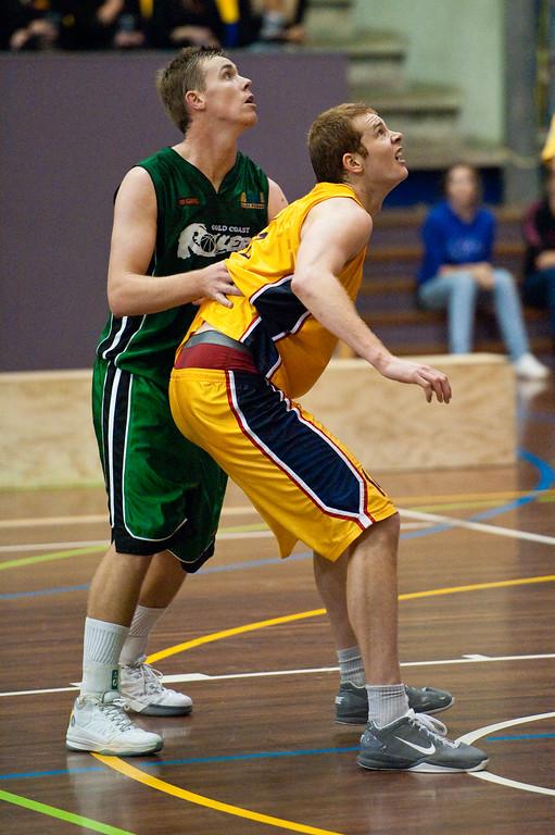 """Tom Garlepp, Dave Gurney - QBL Quarter Final Basketball: Gold Coast Rollers v Brisbane Capitals; Carrara, Gold Coast, Queensland, Australia. Photos by Des Thureson:  <a href=""""http://disci.smugmug.com"""">http://disci.smugmug.com</a>."""
