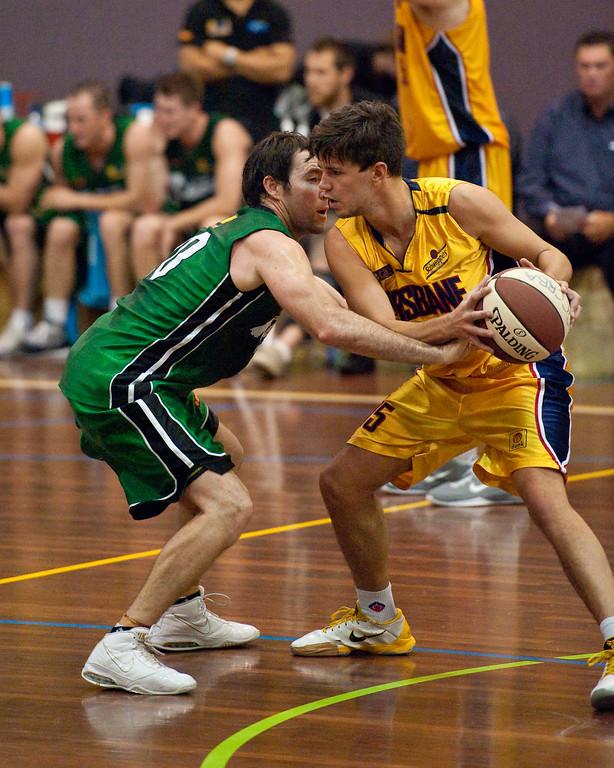 "Adam Darragh, Garrett Scheibner  - QBL Quarter Final Basketball: Gold Coast Rollers v Brisbane Capitals; Carrara, Gold Coast, Queensland, Australia. Photos by Des Thureson:  <a href=""http://disci.smugmug.com"">http://disci.smugmug.com</a>."