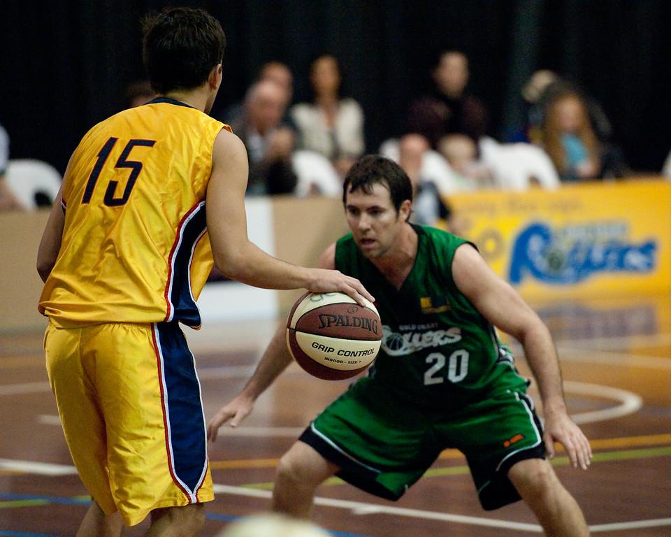 """""""Spalding Grip Control? Yep!"""" - Garrett Scheibner, Adam Darragh - QBL Quarter Final Basketball: Gold Coast Rollers v Brisbane Capitals; Carrara, Gold Coast, Queensland, Australia. Photos by Des Thureson:  <a href=""""http://disci.smugmug.com"""">http://disci.smugmug.com</a>."""