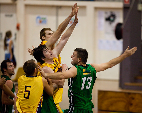 "Matthew Roberts, Scott McGregor - QBL Quarter Final Basketball: Gold Coast Rollers v Brisbane Capitals; Carrara, Gold Coast, Queensland, Australia. Photos by Des Thureson:  <a href=""http://disci.smugmug.com"">http://disci.smugmug.com</a>."