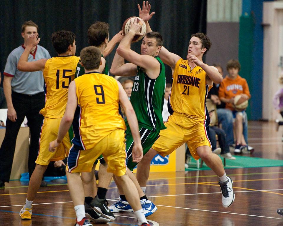 """Garrett Scheibner, Kurt Thompson, Scott McGregor, Jarred Scheibner - QBL Quarter Final Basketball: Gold Coast Rollers v Brisbane Capitals; Carrara, Gold Coast, Queensland, Australia. Photos by Des Thureson:  <a href=""""http://disci.smugmug.com"""">http://disci.smugmug.com</a>."""