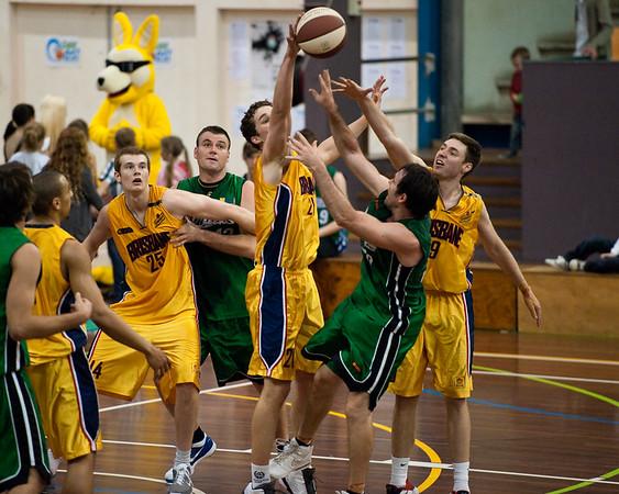 """""""Get That Thing Outa Here!"""" - Jarred Bairstow comprehensively rejects Adam Darragh's shot with the shot clock expiring - QBL Quarter Final Basketball: Gold Coast Rollers v Brisbane Capitals; Carrara, Gold Coast, Queensland, Australia. Photos by Des Thureson:  <a href=""""http://disci.smugmug.com"""">http://disci.smugmug.com</a>."""