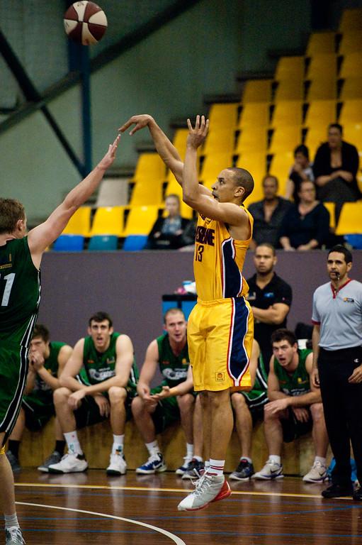 """Nicolas Masunda - QBL Quarter Final Basketball: Gold Coast Rollers v Brisbane Capitals; Carrara, Gold Coast, Queensland, Australia. Photos by Des Thureson:  <a href=""""http://disci.smugmug.com"""">http://disci.smugmug.com</a>."""