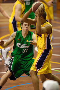 Taylor Barry, Nicholas Masunda - QBL Quarter Final Basketball: Gold Coast Rollers v Brisbane Capitals; Carrara, Gold Coast, Queensland, Australia. Photos by Des Thureson:  http://disci.smugmug.com.