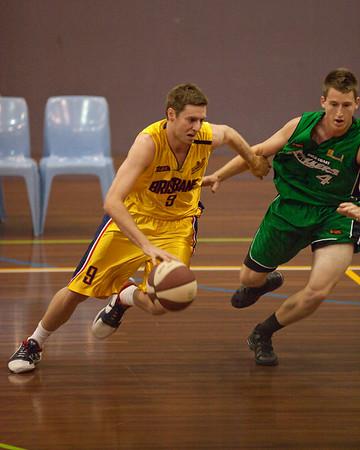 """Karl Nilsson, Kurt Thompson - QBL Quarter Final Basketball: Gold Coast Rollers v Brisbane Capitals; Carrara, Gold Coast, Queensland, Australia. Photos by Des Thureson:  <a href=""""http://disci.smugmug.com"""">http://disci.smugmug.com</a>."""