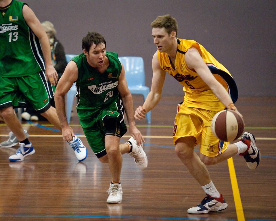 """Adam Darragh, Kurt Thompson - QBL Quarter Final Basketball: Gold Coast Rollers v Brisbane Capitals; Carrara, Gold Coast, Queensland, Australia. Photos by Des Thureson:  <a href=""""http://disci.smugmug.com"""">http://disci.smugmug.com</a>."""