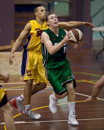 """Dave Gurney, Nicolas Masunda - QBL Quarter Final Basketball: Gold Coast Rollers v Brisbane Capitals; Carrara, Gold Coast, Queensland, Australia. Photos by Des Thureson:  <a href=""""http://disci.smugmug.com"""">http://disci.smugmug.com</a>."""