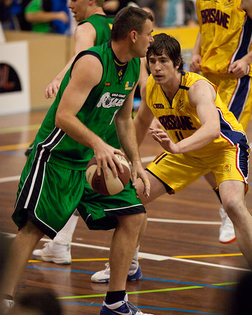 "Scott McGregor, Matthew Roberts - QBL Quarter Final Basketball: Gold Coast Rollers v Brisbane Capitals; Carrara, Gold Coast, Queensland, Australia. Photos by Des Thureson:  <a href=""http://disci.smugmug.com"">http://disci.smugmug.com</a>."