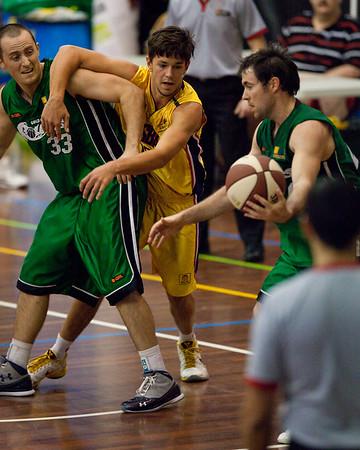 "Adam Darragh, Scott Paget, Garrett Scheibner  - QBL Quarter Final Basketball: Gold Coast Rollers v Brisbane Capitals; Carrara, Gold Coast, Queensland, Australia. Photos by Des Thureson:  <a href=""http://disci.smugmug.com"">http://disci.smugmug.com</a>."