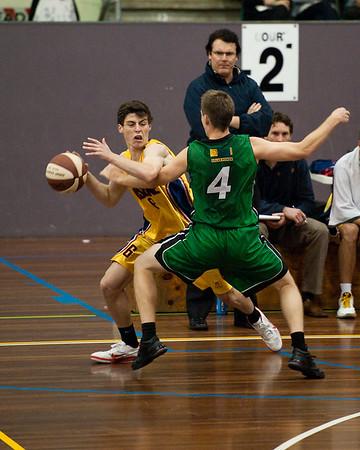 "Karl Nilsson, Ben Wilson and a foul - QBL Quarter Final Basketball: Gold Coast Rollers v Brisbane Capitals; Carrara, Gold Coast, Queensland, Australia. Photos by Des Thureson:  <a href=""http://disci.smugmug.com"">http://disci.smugmug.com</a>."