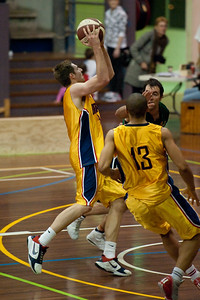 Kurt Thompson, Adam Darragh - QBL Quarter Final Basketball: Gold Coast Rollers v Brisbane Capitals; Carrara, Gold Coast, Queensland, Australia. Photos by Des Thureson:  http://disci.smugmug.com.