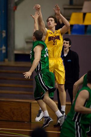 """Scott Paget, Jarred Bairstow - QBL Quarter Final Basketball: Gold Coast Rollers v Brisbane Capitals; Carrara, Gold Coast, Queensland, Australia. Photos by Des Thureson:  <a href=""""http://disci.smugmug.com"""">http://disci.smugmug.com</a>."""