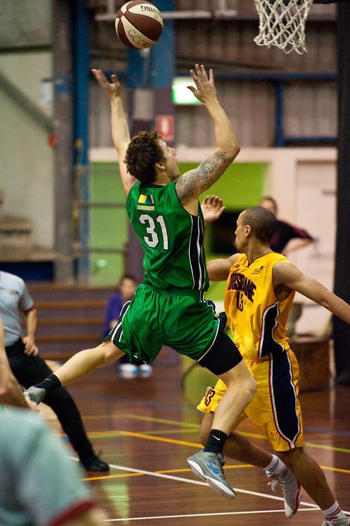 """Taylor Barry, Nicolas Masunda - QBL Quarter Final Basketball: Gold Coast Rollers v Brisbane Capitals; Carrara, Gold Coast, Queensland, Australia. Photos by Des Thureson:  <a href=""""http://disci.smugmug.com"""">http://disci.smugmug.com</a>."""