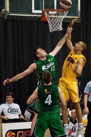 """Nicolas Masunda, Scott McGregor - QBL Quarter Final Basketball: Gold Coast Rollers v Brisbane Capitals; Carrara, Gold Coast, Queensland, Australia. Photos by Des Thureson:  <a href=""""http://disci.smugmug.com"""">http://disci.smugmug.com</a>."""