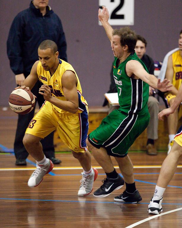 """Nicholas Masunda, Tim Smith - QBL Quarter Final Basketball: Gold Coast Rollers v Brisbane Capitals; Carrara, Gold Coast, Queensland, Australia. Photos by Des Thureson:  <a href=""""http://disci.smugmug.com"""">http://disci.smugmug.com</a>."""