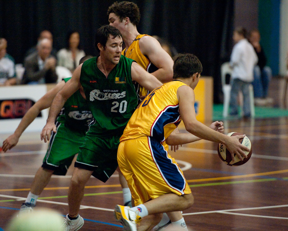 "Garrett Scheibner, Adam Darragh - QBL Quarter Final Basketball: Gold Coast Rollers v Brisbane Capitals; Carrara, Gold Coast, Queensland, Australia. Photos by Des Thureson:  <a href=""http://disci.smugmug.com"">http://disci.smugmug.com</a>."