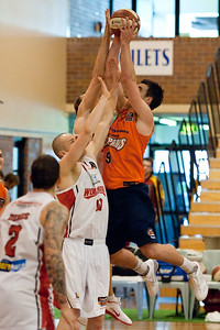 Brad Hill, Glen Saville, Larry Davidson - Cairns Taipans v Wollongong Hawks - Sunshine State Challenge Pre-season NBL Basketball, Southport School, Gold Coast, Queensland, Australia; 22 September 2011. Photos by Des Thureson:  http://disci.smugmug.com.